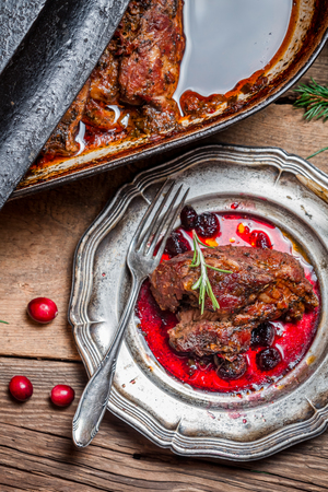 View of venison with cranberry sauce and rosemary photo
