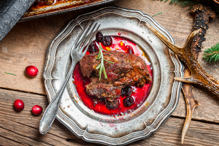 venison: Fresh Venison with cranberry sauce and rosemary