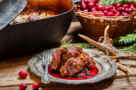 venison: Venison with cranberry sauce and rosemary straight from the forest Stock Photo