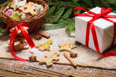 'cinnamon bark': Gingerbread cookies in powdered sugar with cinnamon bark