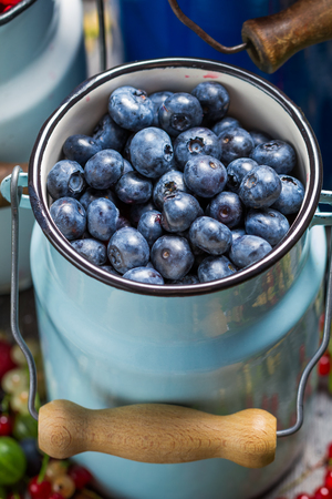 Closeup of fresh berry fruits in churn photo