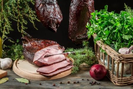 Closeup of freshly smoked ham in a rural pantry Zdjęcie Seryjne