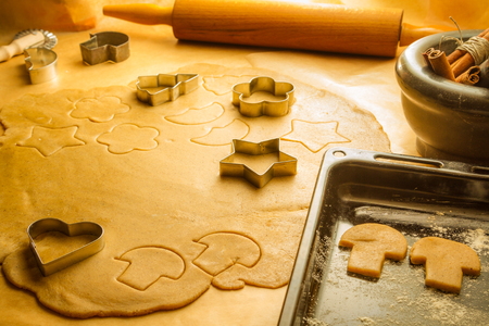 Preparation of gingerbread cookies for Christmas decorations photo