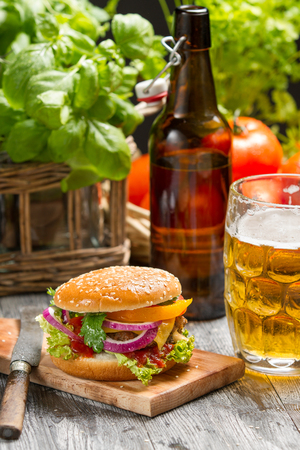 Homemad hamburger and a cold beer photo