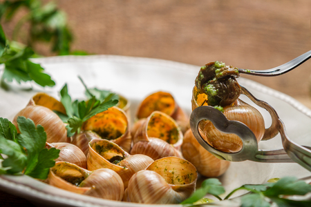 gastronomic: Eating the snail fried in butter with garlic and parsley