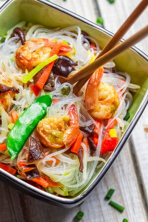 Closeup of chinese mix vegetables and rice noodles photo