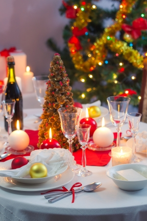 Preparing for Christmas Eve at beautifully decorated table photo