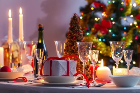 glass christmas tree ornament: Christmas table setting before dinner