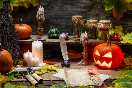 Table in witch hut with halloween pumpkin photo
