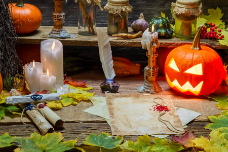 Magic scrolls, pumpkins and candles in the witch's house photo