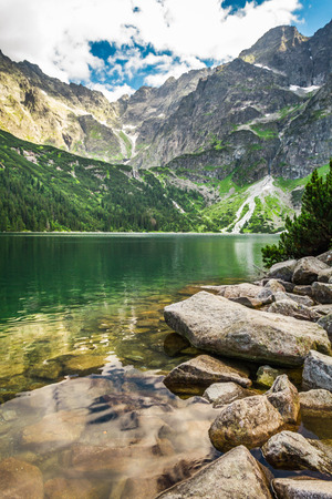Beautiful lake with clear water in the mountains photo