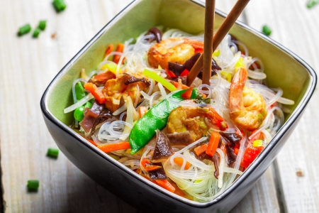 Chinese mix vegetables and rice noodles on old wooden table photo