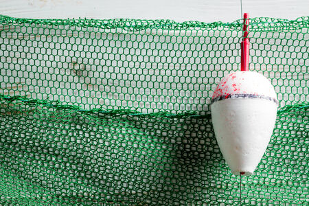 Green fishing net with floats photo