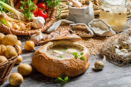 Homemade sour soup in bread with marjoram photo