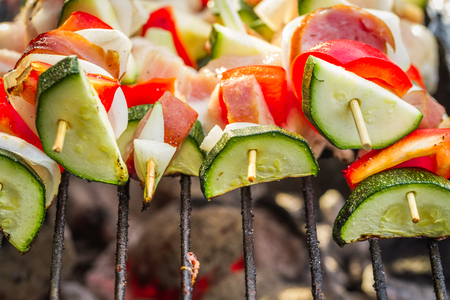 broiling: Skewers with vegetables on the grill
