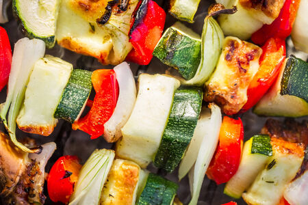 Closeup of hot skewers on the grate photo