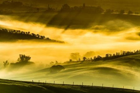 Foggy meadows in the morning, Tuscany photo