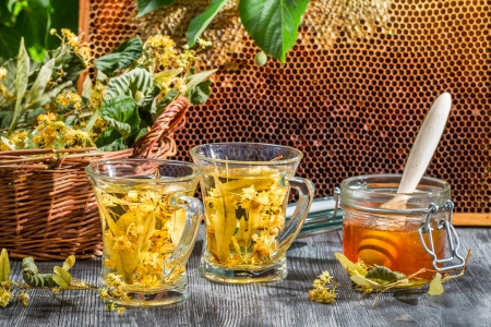Tea made of lime and honey served in the garden photo