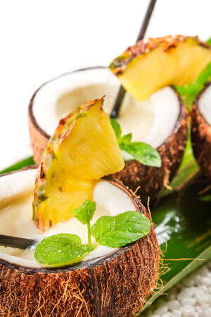 Closeup of pinacolada in a coconut photo