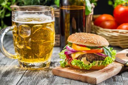 Closeup of homemade burger and a cold beer photo
