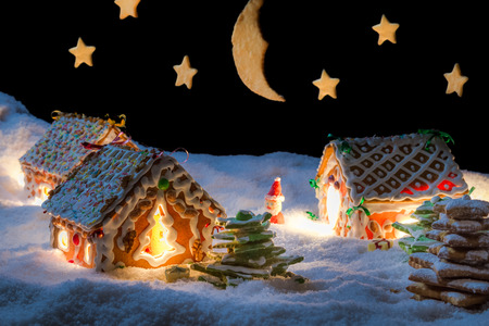 christmas landscape: Snowy gingerbread village with stars Stock Photo
