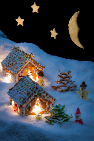 Snowy gingerbread cottage with stars and moon Archivio Fotografico