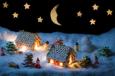 Cozy gingerbread cottage in snow Archivio Fotografico