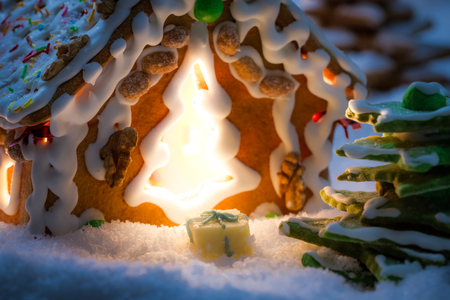 Closeup of marzipan gift near gingerbread cottage