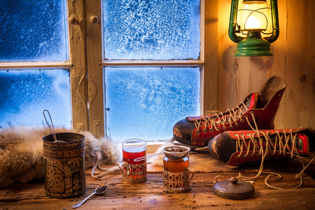 Hot tea in cold winter evening photo
