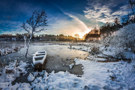 Winter sunrise on the frozen lake photo