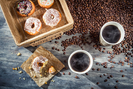 Coffee with donuts  for two photo