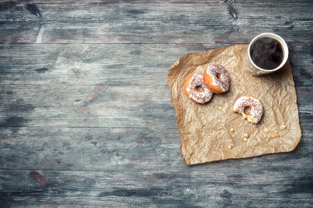 chocolate background: Donuts, coffee and wooden table  Stock Photo