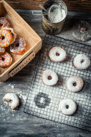 Tasting sweet donuts with icing sugar photo