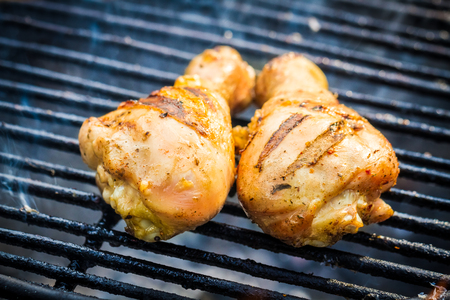grill tongs sausage: Barbecue Chicken at summer on grill Stock Photo