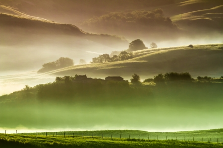 Morning fog in countryside Tuscany photo