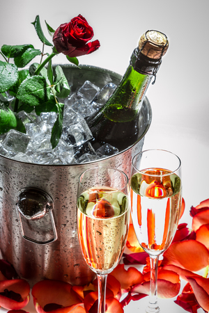 Red rose and cold champagne for Valentine photo
