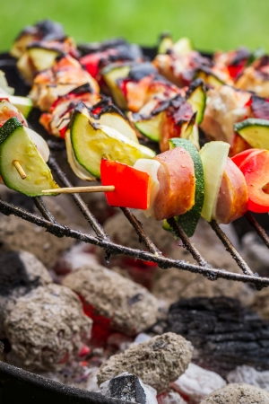 Hot skewers on the grill with fire photo