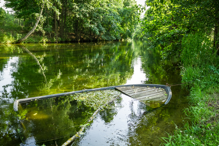 sunk: Damaged boat sunk by the river
