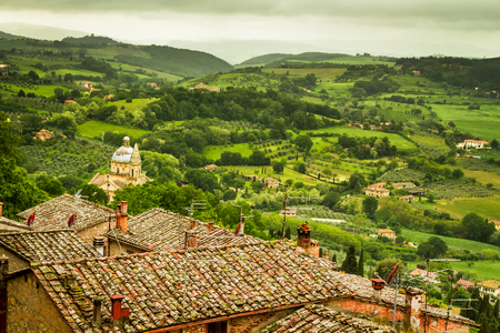 volterra: Green valley and red roofs in Volterra, Italy