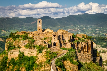 Ancient city on hill in Tuscany on a mountains background. photo
