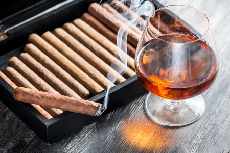 Aroma of cognac and smoking a cigar photo