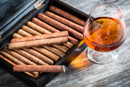 Cigars in humidor and cognac photo