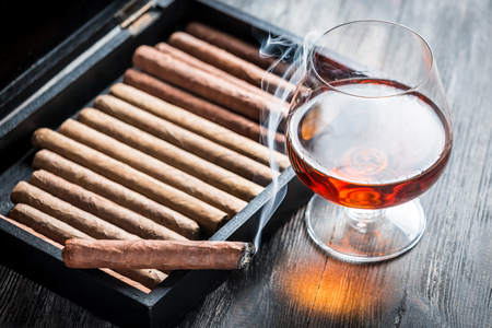 Rising aroma of burnt cigar and cognac photo