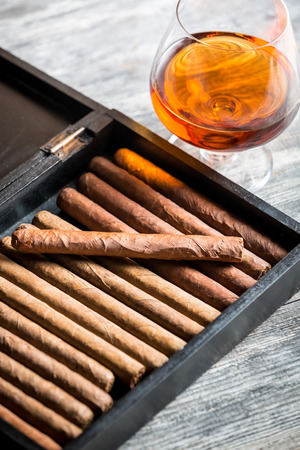 Humidor full of cigars and cognac photo
