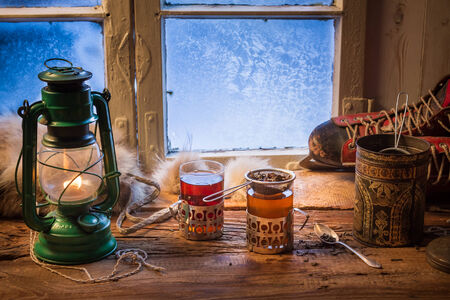 Hot tea in a small house at winter photo