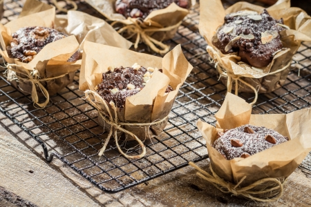 Muffins with icing sugar and almonds