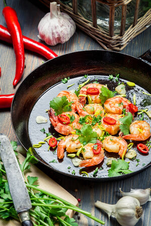 Shrimps served on a pan with herbs photo