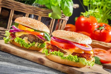 chicken burger: Closeup of two homemade hamburgers