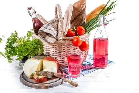 Picnic basket with vegetables and cheese