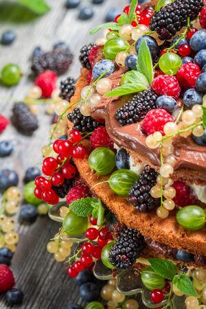 Closeup of cake wild fresh berry fruits photo